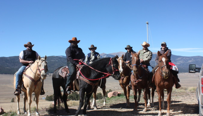 Elk Hunters On Horses